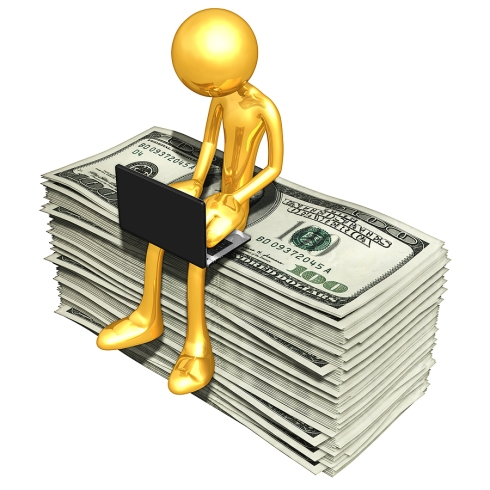 bigstock_Gold_Guy_Online_With_Money_6741622